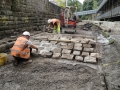 Laying cobbles.JPG