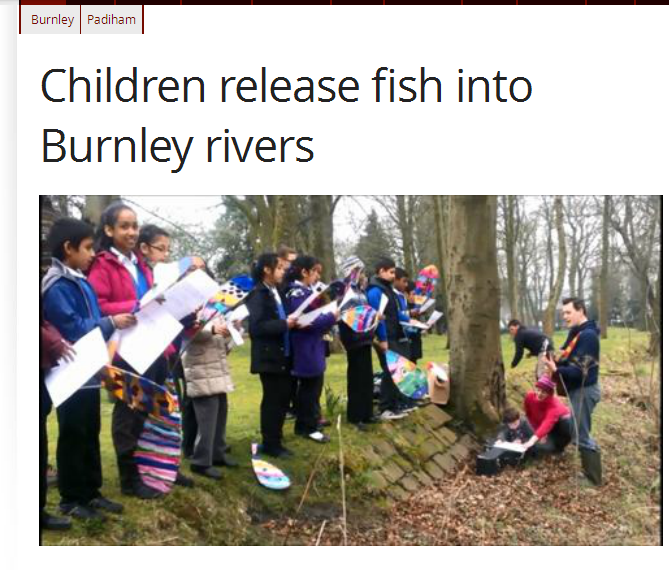Press coverage as children walk to their river to release their fish